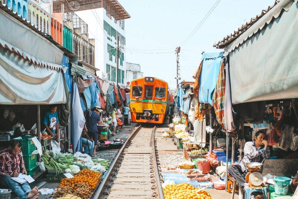 train-approaching-maeklong-railway-market-bangkok-thailand